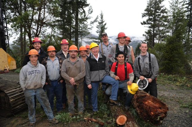 Secretary Salazar (center) poses for a pictures with workers of the Medford Pilot Project, one of three ecological forestry pilot projects in Oregon.