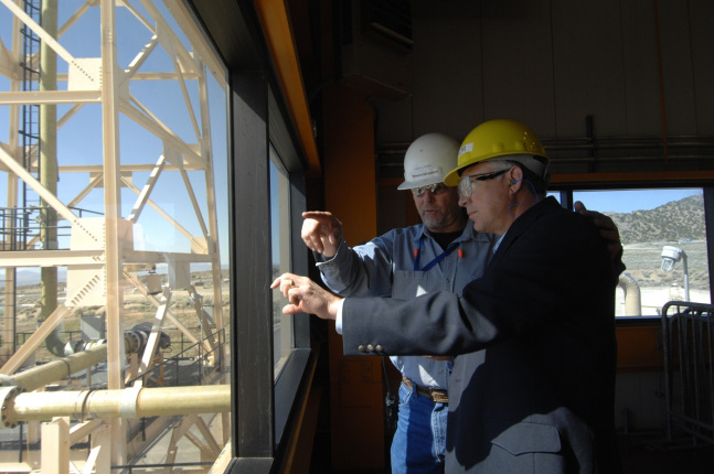Garth Larsen, Plant Manager, Blundell Geothermal Plant and Secretary Ken Salazar tour the plant in Utah. During this trip, Salazar announced that the Bureau of Land Management has authorized expanded use of agency lands to assist the geothermal plant to i