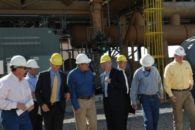 Jim Gazewood, Bureau of Land Management Renewable Energy Coordinator, Steve Black, Rich Walje, President Rocky Mountain Power Secretary Salazar, Alan Gilbert, and Garth Larsen, Plant Manager, Blundell Geothermal Plant stand outside the plant near Milford,