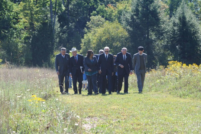 Vice President Biden and Secretary Salazar walk with the families of Flight 93 and community members who assisted in the aftermath of 9/11 at the Flight 93 Memorial.