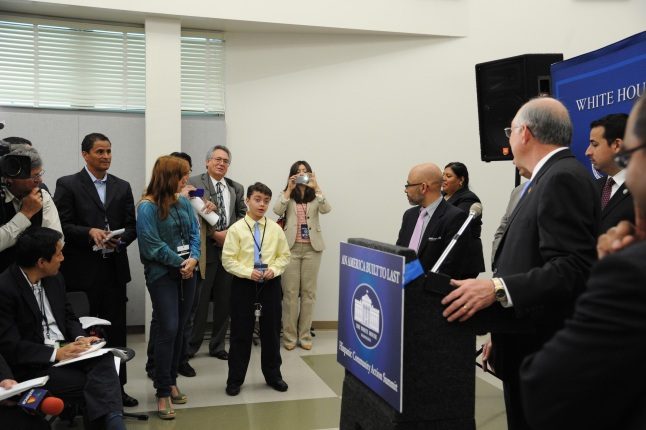 Secretary Salazar speaks to a child during a press conference.