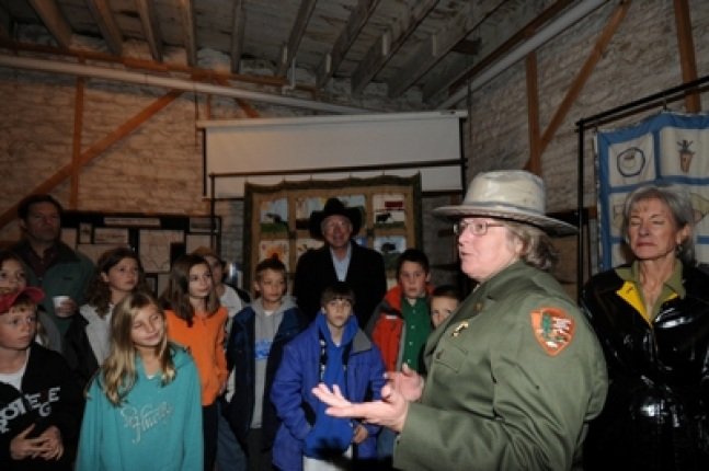 Tallgrass Prairie National Preserve Superintendent Wendy Lauritzen speaks as children listen.