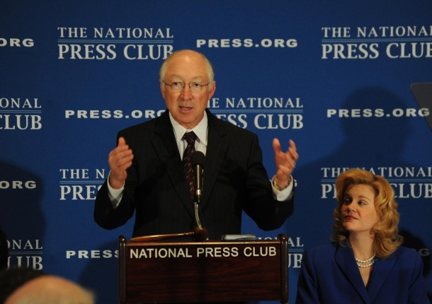 Secretary Salazar speaking at the National Press Club with National Press Club President Theresa Werner sitting next to him.