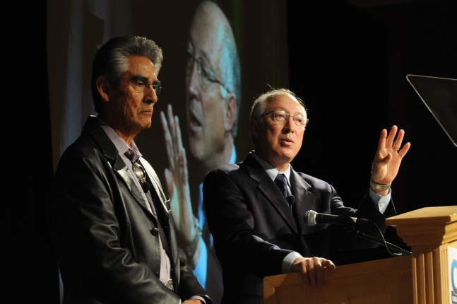Navajo Nation President Joe Shirley and Secretary of the Department of the Interior Ken Salazar speak at podium.