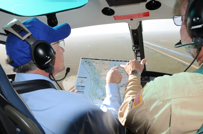 Secretary of the Department of the Interior Ken Salazar and Glen Cullingford, Southwest Pilot for the Fish and Wildlife Services review a map of the Everglades and Tamiami Trail.
