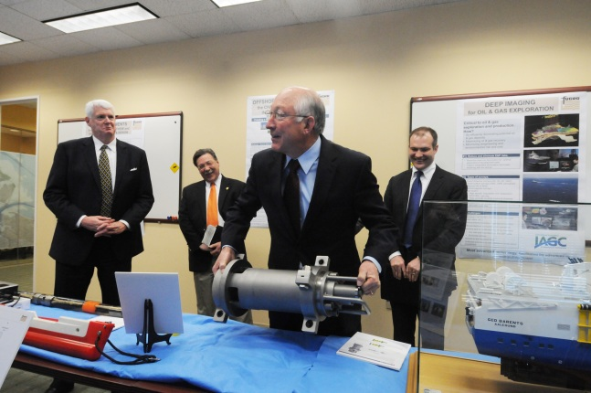 Secretary Salazar picks up an acoustical source.