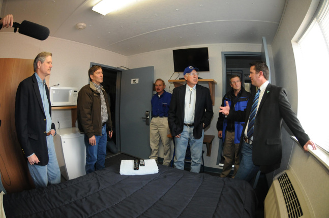 Secretary Salazar touring a private housing accommodations for oil rig workers.