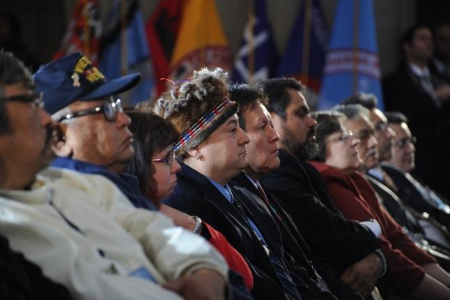 Audience members listen