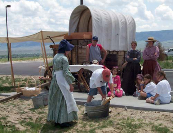 Visitors at the National Interpretive Center learning about the everyday chores of those who traveled the trails.