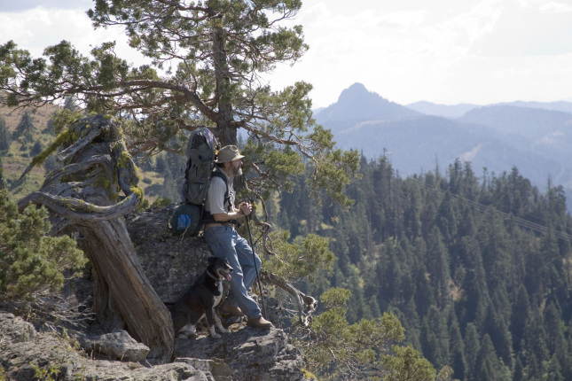 Hiker and dog enjoying the view at Hobart Overlook within Cascade-Siskiyou National Monument.