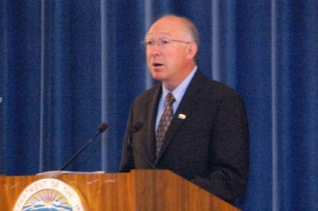 Secretary Salazar speaking at podium.