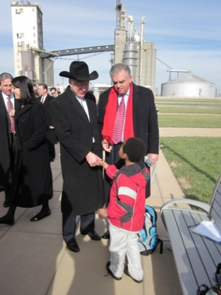 Secretaries Salazar and LaHood greet a young boy.