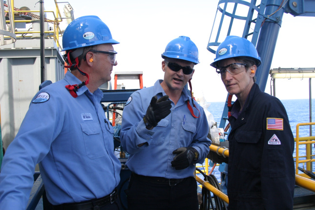 Secretary Jewell with workers on a rig