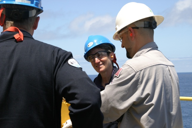 Secretary Jewell speaking with workers on an oil rig