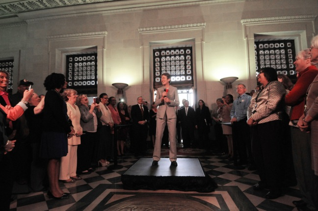 Secretary Jewell addresses Interior employees inside the Udall Building's C St Entrance.