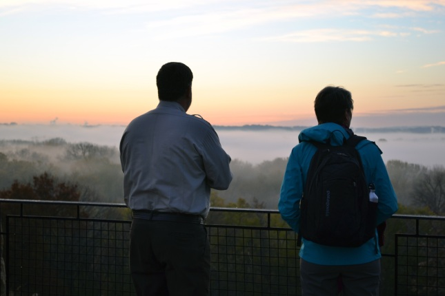 Refuge Manager Tim Bodeen takes in the sunrise with Secretary Sally Jewell at Minnesota Valley National Wildlife Refuge.
