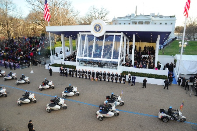 A police motorcade passes on parade.