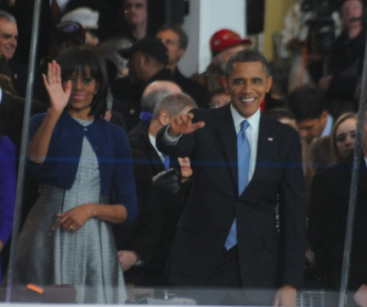First Lady Michelle and President Barack Obama wave during the inaugural parade.