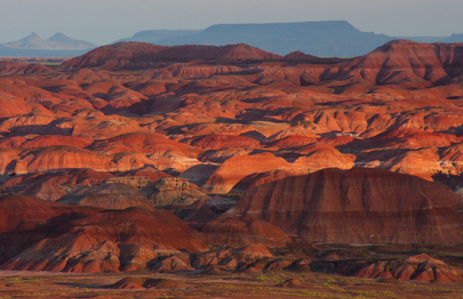 Multi-colored hills glow in the setting sun