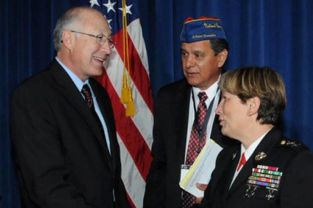 Secretary Salazar greeting Albert Gonzalez, Commander of the American G.I. Forum and Major General Angela Salinas.