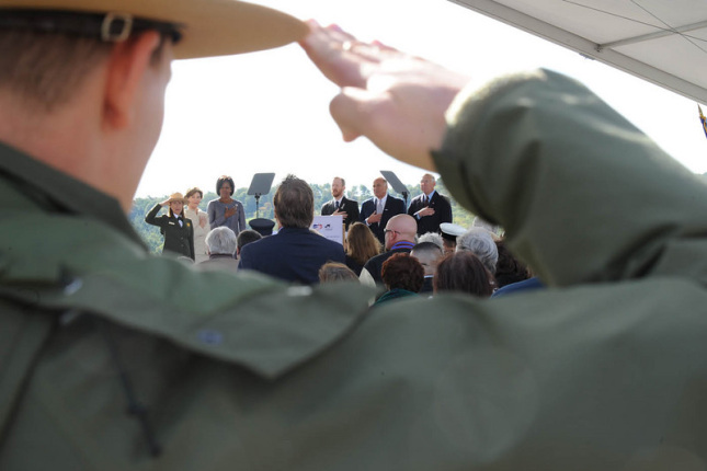 A Park Service Ranger salutes during the memorial service.