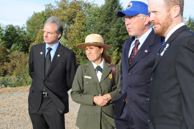 Looking out over the area where Flight 93 crashed, left to right are Neil Mulholland, Memorial Superintendent Joanne Hanley, Secretary Salazar, and Gordon Felt.