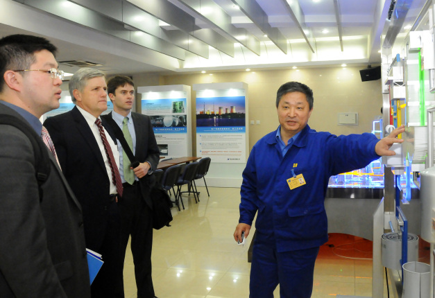 Deputy Director David Hayes learns about the carbon capture and storage demonstration project at the Huaneng Co-generation power plant near Beijing, China.