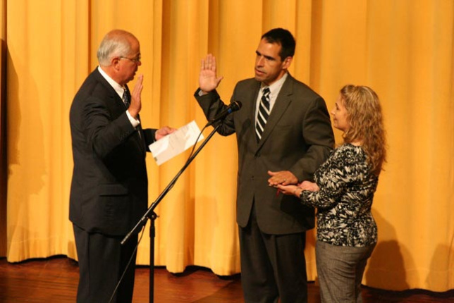 Assistant Secretary-Indian Affairs Larry Echo Hawk administering the oath of office to James C. Redman at his inauguration as Haskell Indian Nations University's sixth president in Lawrence, KS.