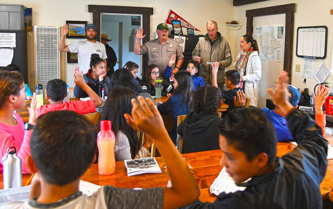 Secretary Zinke in a classroom with many students along with Park employees