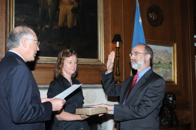 Secretary of the Interior Ken Salazar swears in Michael Bromwich as the Director of the BOE, as Communications Director Betsy Hildebrand helps to officiate.