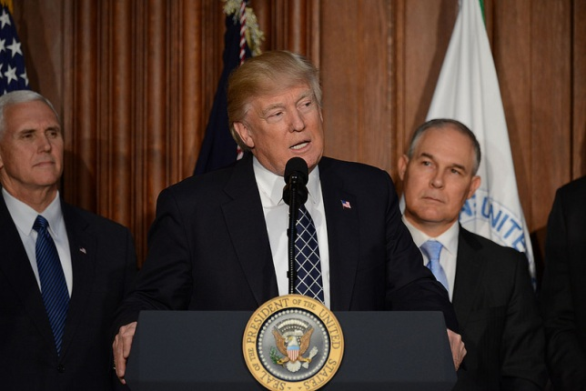 President Trump speaks at lectern flanked by Vice-President Pence stage right and Administrator Pruitt at stage-left