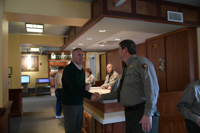 Secretary Zinke at Visitors Center shakes hands with Park employees