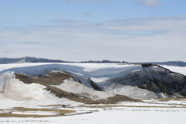 Large snow drifts on hills