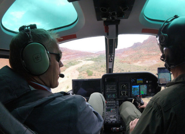 Secretary Zinke sits in the cockpit of aircraft next to the pilot