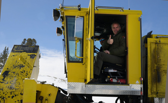 Secretary Zinke in snow removal machine giving a thumbs up