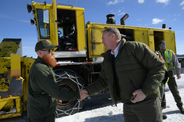 Secretary Zinke shakes the hand of Park employee with large red beard