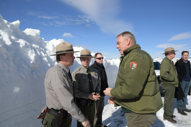 Secretary Zinke discusses a matter with Park employees
