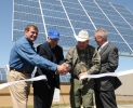 Rich Walje President of Rocky Mountain Power, Secretary Ken Salazar, teacher Andy Swapp, and Superintendent Ray Terry dedicate new solar panels at Milford High School.