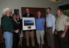 Secretary Salazar presents David Govatski with the 2012 Refuge System Volunteer of the Year Award.