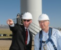 CEO First Wind Paul Gaynor speaks with Secretary Ken Salazar before Salazar visits the top of one of the 97 wind towers in the Milford Wind Corridor.