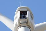 Secretary Ken Salazar looks out from the top of a wind tower in the Milford Wind Corridor.