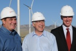 Rich Walje, President Rocky Mountain Power, Secretary Ken Salazar, and Paul Gaynor, CEO First Wind, in front of wind turbines at the Milford Wind Corridor.