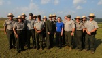 Secretary Jewell with members of the National Parks Service on the Memorial Field