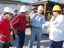 During his visit to Port Fourchon this morning, Secretary of the Interior Ken Salazar is briefed by Ron Ferguson, BP's Gulf of Mexico Shore Base coordinator, on the 40-foot metal containment structure that is being transported to the site of the leak