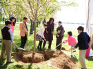 First Lady Michelle Obama with children at the Cherry Blossom Tree planting re-enactment ceremony along the Tidal Basin.
