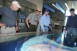 Secretary Salazar, and Will Shafroth view a map of the loop current off the coast of the Florida Keys.