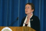 GSA Administrator Martha Johnson speaking at podium.