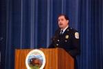 Lt. David Mulholland speaking at podium.