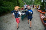 Children helping push a raft near the Chattahoochee River