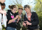 Secretary Jewell and NPS Director Jarvis with a student studying nature